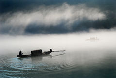 Boat in the fog. Boat in the morning fog royalty free stock images