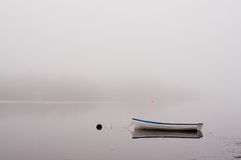 Boat in fog. A rowboat in Atlantic ocean fog Royalty Free Stock Image