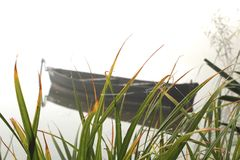 Boat in the fog. On the lake Royalty Free Stock Photos