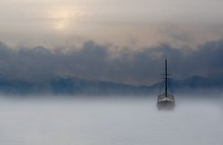 Boat and Fog. A boat in the middle of the fog in the lake Royalty Free Stock Images