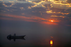 Boat and fog during sunrise Stock Photography