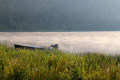 Boat on Foggy Lake Royalty Free Stock Images