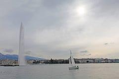 Boat and fountain on Geneva lake Royalty Free Stock Photos