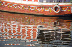 Boat fragment and reflections on Ganges river,India Stock Images
