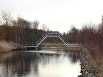 Boat Friendly Designed Bridge at Small River Royalty Free Stock Photo