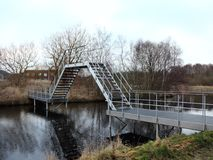 Boat Friendly Designed Bridge at Small River Stock Images