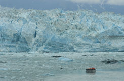 Boat in Front of Hubbard Glacier Royalty Free Stock Images