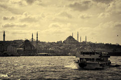 boat on front of istanbul royalty free stock photo