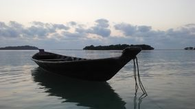 Boat in front of Ko Na Thian and Ko Mat Lang Islands during Sunrise on Koh Samui Island, Thailand. Royalty Free Stock Photography