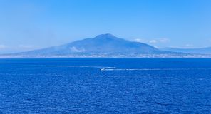 Boat in front of Mount Vesuvius in Bay of Naples at Sorrento res. Ort town Royalty Free Stock Images