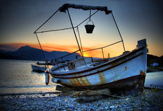 Boat in front of the sunset-Mykonos Stock Photos