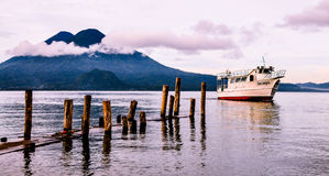Boat in front of volcano. In Latin America Stock Photography