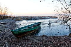 Boat froze in ice. The boat froze in ice and waits for spring Royalty Free Stock Photography