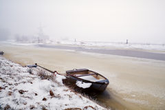 Boat on frozen canal in Netherlands Royalty Free Stock Photo
