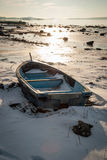 Boat frozen in fjord in winter sunshine Royalty Free Stock Photography