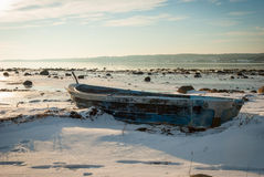 Boat frozen in fjord in winter sunshine Stock Photography