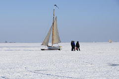 Boat on a frozen lake Royalty Free Stock Photography