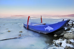 Boat on frozen Trasimeno lake, Italy Stock Photo