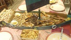 Boat full of fish in italian restaurant royalty free stock photos