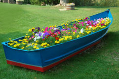 Boat full of flowers. An old row boat has been turned into a flower garden on the shore of Lake Michigan, USA stock images