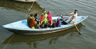 Boat full of people on Ganges river Stock Image