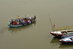 Boat full of people on Ganges river stock photo