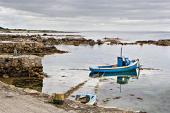 Boat on Galway Bay. A boat tied up on the edge of Galway Bay, Ireland Royalty Free Stock Photo
