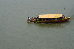 Boat on the Ganges. River with lot people in it. Varanasi, India royalty free stock images