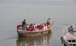 Boat on the ganges. Colorful people are sitting in a boat on the holy river Ganges Royalty Free Stock Photography
