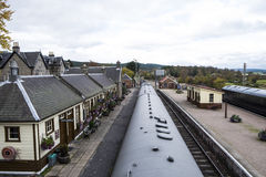 Boat of Garten Railway Station, Scottish Highlands. Looking down from footbridge to Boat of Garten Railway Station and along the Strathspey Railway in Scottish stock images