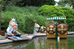 Boat and gauls and Asterix and Obelix dolls from Epidemais Croisiere attraction at Park Asterix, Ile de France, France Stock Photography