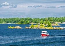 Boat on Georgian Bay. Small boat on lake near island in Georgian Bay, Ontario Canada stock photos