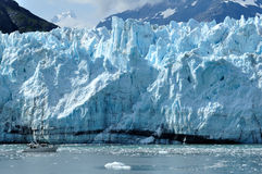 Boat Giving Scale to Margerie Glacier, Alaska Royalty Free Stock Images