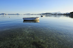 Boat on glassy water Royalty Free Stock Photo