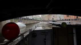 The boat goes through the channel in center St. Petersburg, the river bus. The boat goes through the channel in center St. Petersburg, shooting from floating stock footage