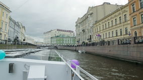 The boat goes through the channel in center St. Petersburg. The river bus. The boat goes through the channel in center St. Petersburg, shooting from floating stock video