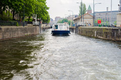Boat going through Berlin gateways Royalty Free Stock Images