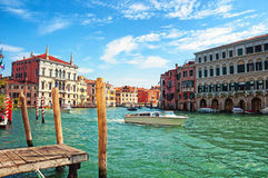 Boat going by the canals in Venice Stock Photography