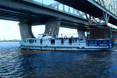 Boat going on the river. Touristic boat on the Dnieper river in Kiev. Motorboat. Boat going on the river. Touristic boat on the Dnieper river in Kiev Stock Photography