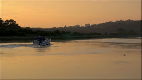 Boat going up the river avon. Boat traveling up the river Avon at sunset stock video