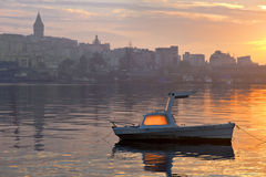 Boat in Golden Horn at dawn Royalty Free Stock Photos