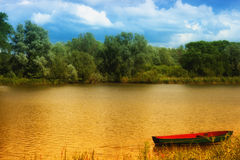 Boat on a golden pond Royalty Free Stock Images