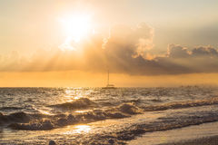 Boat and golden sunrise over ocean in Dominican Republic Stock Image