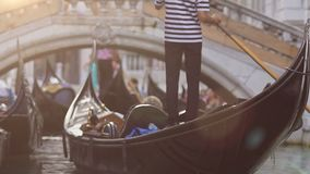 Boat with gondolier and passengers waiting to go under bridge, congestion ahead. Stock footage stock video