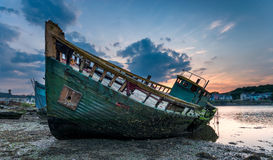 Boat Graveyard. Decaying old boat wreck abandoned on the shore of Hooe Lake in Plymouth, Devon stock image
