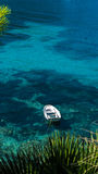 Boat in greece on cristal clear water Stock Images