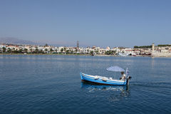 Boat. GREECE, RETHYMNO - JULY 29, 2011. An elderly man is on a boat royalty free stock photography