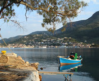 Boat in Greece. Traditional boat under tree in Vathi, Ithika, Greece royalty free stock photography