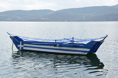 Boat with greek flag painted on it Stock Images