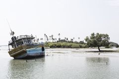 Boat on groundwater in trincomalee because of tsunami. Boat on land because of tsunami in trincomalee in sri lanka Stock Image